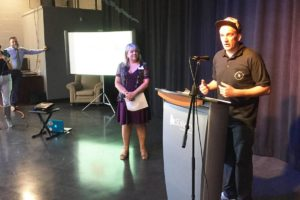 Mattias Boon, founder and director of StreetRich Hip Hop Society, speaks to crowd Tuesday at Whalley's new arts hub, at 10660 City Parkway, with Ellie King of Royal Canadian Theatre Company to his right. (photo: Tom Zillich)